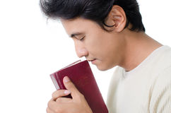 Pregare dell'uomo. Immagine Stock