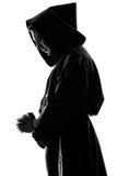 Pregare della siluetta del sacerdote del monaco dell'uomo Immagine Stock Libera da Diritti