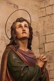 Pregare di Staint Immagine Stock