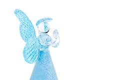 Pregare di vetro blu di angelo isolato su fondo bianco Fotografia Stock