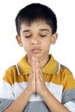 Pregare indiano del ragazzo Immagini Stock