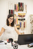 Pregenant woman orking in clothes store Stock Photo