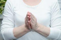 Preghi il gesto Immagine Stock