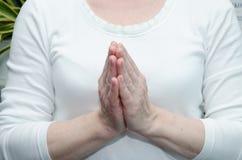 Preghi il gesto Immagini Stock