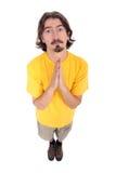Preghiera casuale dell'uomo fotografia stock
