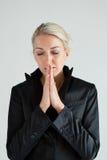 Preghiera delle donne di affari Immagine Stock