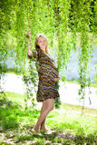 Pregnancy. Beautiful pregnant woman in park stock image