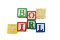 Pregnancy. Words 'Boy or Girl' in alphabet letter blocks stock photo
