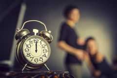 Pregnancy and alarm clock Royalty Free Stock Images