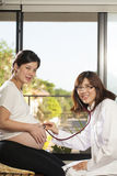 Pregnancy. An Asian doctor use stethoscope check at pregnancy belly of Asian woman Royalty Free Stock Images