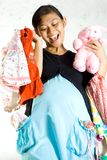 Pregnancy and baby clothing shopping Stock Images
