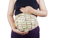 Pregnancy with baby names on her belly Stock Images