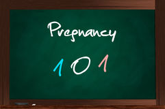 Pregnancy 101. Chalkboard with Pregnancy 101 written on it stock illustration