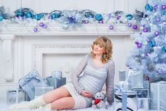 Pregnancy and Christmas, people and expectation concept - happy pregnant woman touching her belly. Stock Photography
