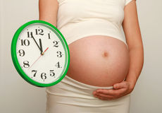 Pregnancy and clock Royalty Free Stock Image