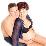 love and pregnancy- pregnant woman and husband Stock Images