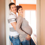 love and pregnancy- pregnant woman and husband Stock Photos