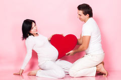 Pregnant couple with heart Stock Photo