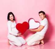 Pregnant couple with heart Royalty Free Stock Photography