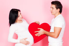 Pregnant couple with heart Stock Image