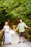 Pregnancy: A Couple Walking Outside Stock Photography