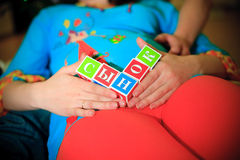 Pregnancy and cubes in words Stock Image