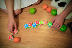 Pregnancy and cubes in words Stock Photo