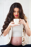 Pregnancy, drinks, people and expectation concept - close up of Royalty Free Stock Photography