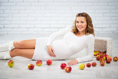 Pregnancy, healthy eating and people concept - close up of a happy pregnant woman. Royalty Free Stock Photography