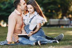 Loving husband kissing his pregnant wife. royalty free stock images