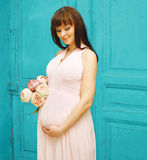 Pregnancy, motherhood and happy future mother concept - woman Stock Photography