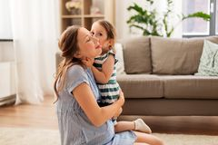 Pregnant mother and daughter hugging at home royalty free stock photos