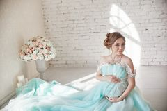 Pregnancy, pregnant woman, family planning, caesarean section delivery, waiting for delivery. Depression and vitamins for healthy. Growth. A woman in a long Stock Photos