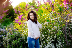 Pregnancy Pregnant woman in the garden. Concept health. new life stock photography