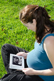 Pregnancy - Pregnant woman looking at ultrasound scan Stock Photo