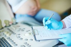 Pregnancy record keeping Stock Images