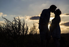 Pregnancy at sunset royalty free stock image