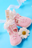 Pregnancy test and baby shoes. Pregnancy test and pink baby shoes for little girl Royalty Free Stock Photography