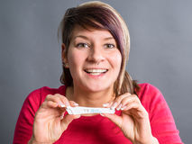 Pregnancy test - happy surprised woman stock photos