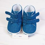 Pregnancy test with positive result and baby shoes for newborn, expecting for baby concept. Pregnancy test with positive result and blue baby shoes for newborn stock photography
