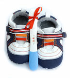 Pregnancy test positive result with baby shoes and present red r Stock Photo