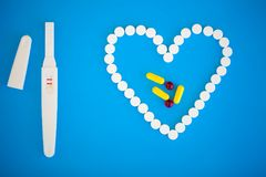 Pregnancy test. The result is positive with two strips. Treatment of infertility with pills, help in conceiving a child. Tablets. From pregnancy do not work stock photography