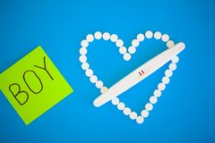 Pregnancy test. The result is positive with two strips. Treatment of infertility with pills, help in conceiving a child. Tablets from pregnancy do not work stock image