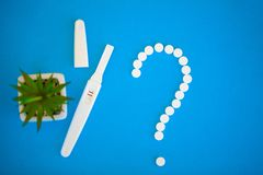 Pregnancy test. The result is positive with two strips. Treatment of infertility with pills, help in conceiving a child. Tablets. From pregnancy do not work stock photos