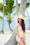 Pregnancy and travel.  Sea, beach, palm trees, exotic island. Stock Images