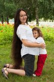 Pregnancy woman and her little daughter Royalty Free Stock Image