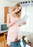 Pregnancy woman looking paper Royalty Free Stock Image