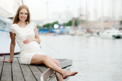 Pregnancy woman  near sea port Royalty Free Stock Photos