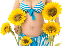 Pregnancy woman with sunflowers. It is a pregnancy woman stock image