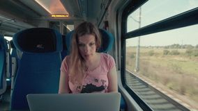 Pregnancy Woman Working with Laptop on a Train stock video